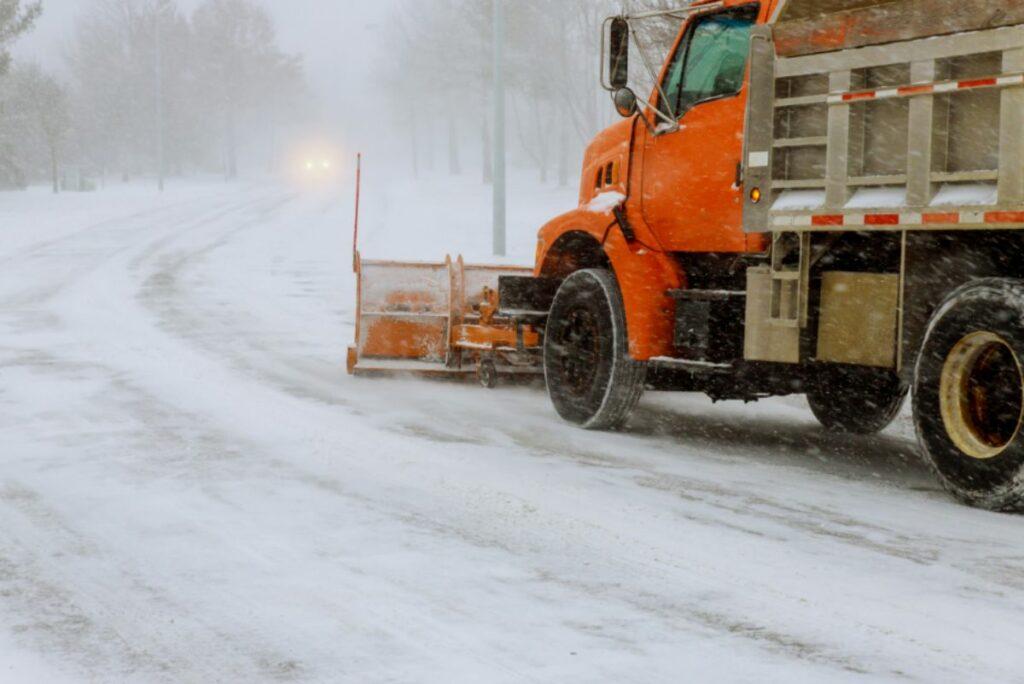 Truck plowing snow